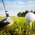 Playing golf. Club and ball on tee